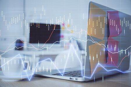 Forex market graph hologram and personal computer on background. Double exposure. Concept of investment. 写真素材