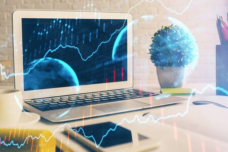 Stock market graph and table with computer background. Multi exposure. Concept of financial analysis. Фото со стока