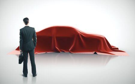 businessman looking on presentation of the new sport car model