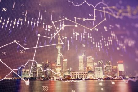 Financial graph on night city scape with tall buildings background multi exposure. Analysis concept. Stock fotó