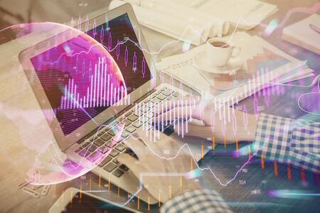 Double exposure of forex graph with man working on computer on background. Concept of market analysis. Stock fotó