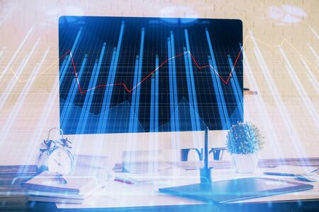 Multi exposure of forex graph and work space with computer. Concept of international online trading. Stock Photo