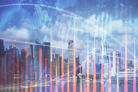 Forex chart on cityscape with skyscrapers wallpaper multi exposure. Financial research concept. 스톡 콘텐츠