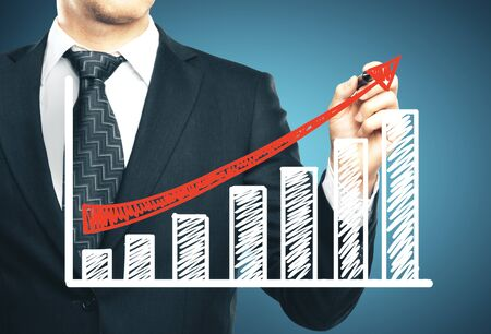 Businessman hand drawing stock market infographic. Business success concept