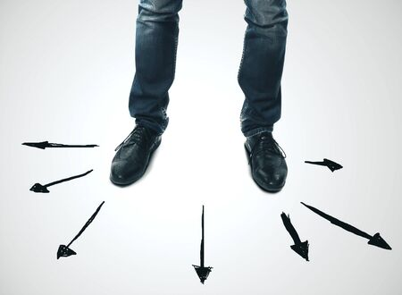 Foot and businessman stand on arrows on abstract gray background. Different direction and path concept