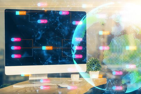 Multi exposure of table with computer and world map hologram. International data network concept. 写真素材