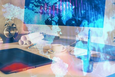 Forex market graph hologram and personal computer on background. Double exposure. Concept of investment. 스톡 콘텐츠