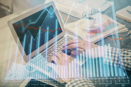 Double exposure of forex graph with man working on computer on background. Concept of market analysis. Zdjęcie Seryjne