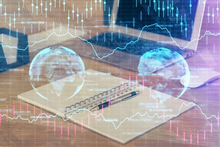 Multi exposure of graph and financial info and work space with computer background. Concept of international online trading. 스톡 콘텐츠