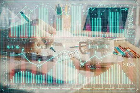 Financial chart drawn over hands taking notes background. Concept of research. Double exposure