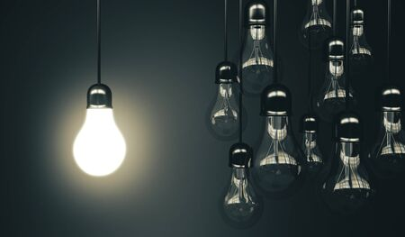 Many lamp hanging the wire and one glows. Business idea concept. 3d rendering 스톡 콘텐츠