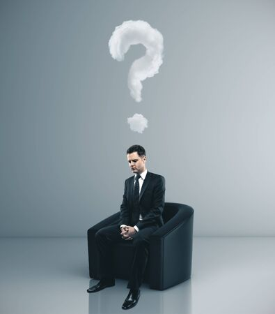 Businessman sitting in chair with drawing question mark over head. Business problem concept