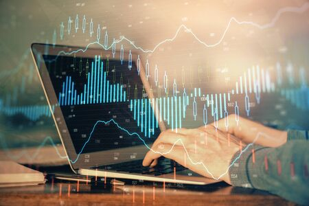 Double exposure of businessmans hands withcup of coffee with stock market graph background. Concept of research and trading. Stok Fotoğraf