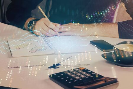 Double exposure of man doing analysis of stock market with forex graph.