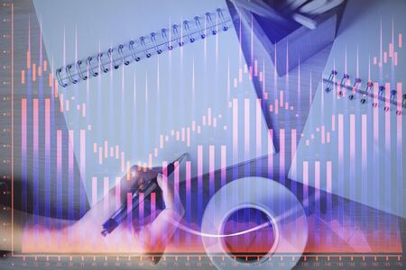 Multi exposure of womans hands making notes with forex graph hologram. Concept of technical analysis. Stok Fotoğraf