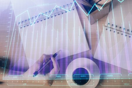 Multi exposure of hands making notes with forex chart huds. Stock market concept. Stok Fotoğraf
