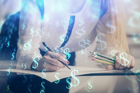 Double exposure of hands making notes with forex chart huds. Stock market concept. Stok Fotoğraf