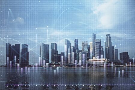 Gráfico de Forex en paisaje urbano con exposición múltiple de fondo de edificios altos. Concepto de investigación financiera. Foto de archivo