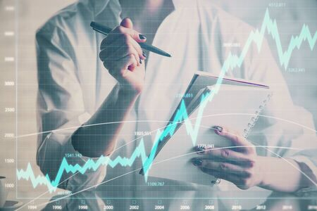 Financial chart drawn over hands taking notes background. Concept of research. Multi exposure