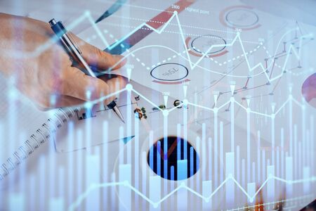 Multi exposure of man planing investment with stock market forex chart.