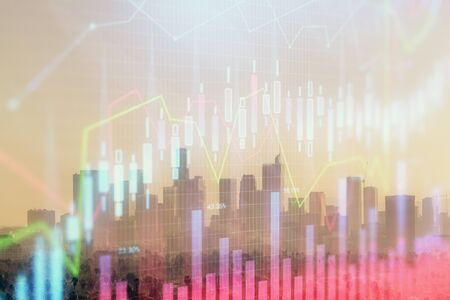 Forex chart on cityscape with skyscrapers wallpaper multi exposure. Financial research concept. Banco de Imagens