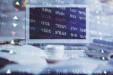Forex market chart hologram and personal computer background. Double exposure. Concept of investment. 스톡 콘텐츠
