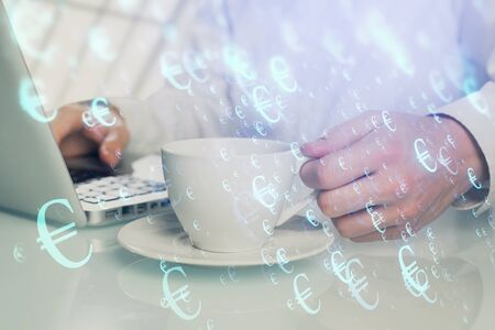 Double exposure of graph with man typing on computer in office on background. Concept of hard work. Banco de Imagens