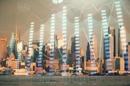 Forex graph on city view with skyscrapers background double exposure. Financial analysis concept. Reklamní fotografie