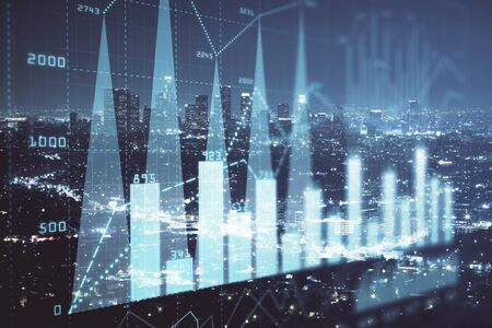 Financial graph on night city scape with tall buildings background multi exposure. Analysis concept. Reklamní fotografie
