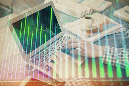 Double exposure of forex graph with man working on computer on background. Concept of market analysis. Reklamní fotografie