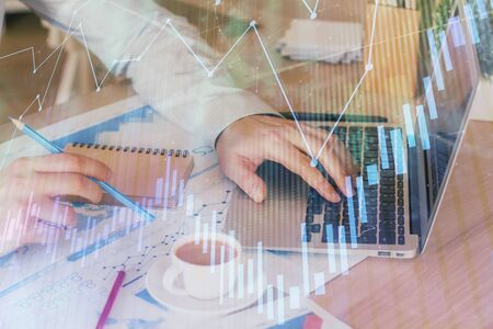 Forex graph with businessman working on computer in office on background. Concept of hardworking. Multi exposure.