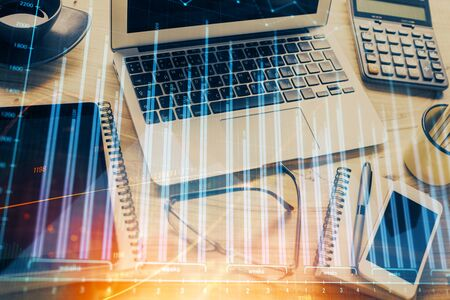 Financial graph colorful drawing and table with computer on background. Multi exposure. Concept of international markets.
