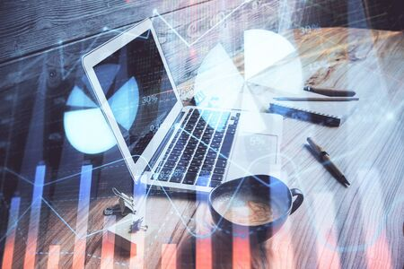 Double exposure of forex chart and work space with computer. Concept of international online trading. Reklamní fotografie