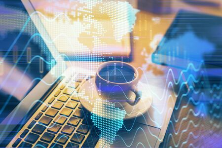 Financial chart drawing and table with computer on background. Multi exposure. Concept of international markets. Reklamní fotografie