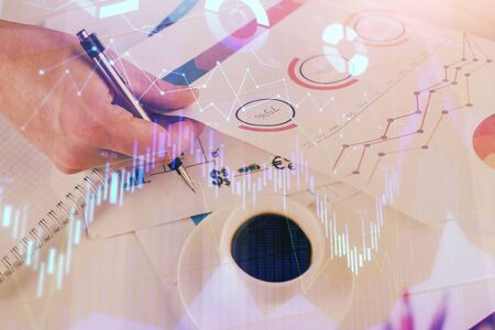 Multi exposure of man planing investment with stock market forex chart background. Concept of research and trading.