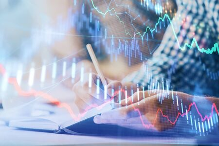Multi exposure of two men planing investment with stock market forex chart background. Concept of research and trading. 版權商用圖片
