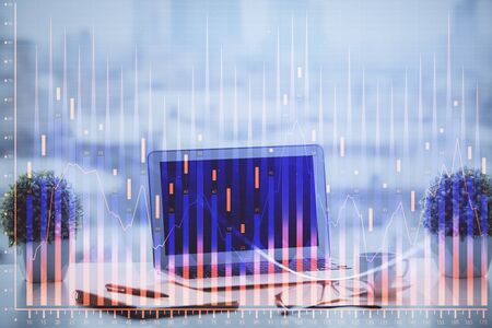 Stock market chart hologram drawn on personal computer background. Double exposure. Concept of investment. Reklamní fotografie - 135499300