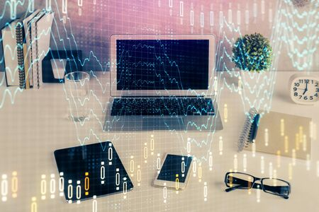 Forex market graph hologram and personal computer on background. Multi exposure. Concept of investment. Reklamní fotografie - 135499650