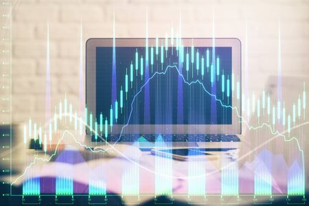 Forex market chart hologram and personal computer background. Multi exposure. Concept of investment. Reklamní fotografie - 135499451