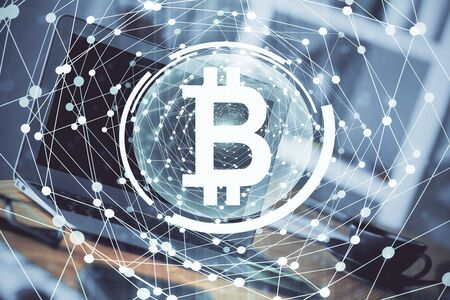 Multi exposure of blockchain theme hologram and table with computer background. Concept of bitcoin crypto currency. Reklamní fotografie - 135499504