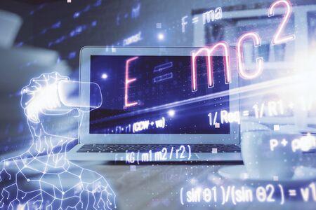 Desktop computer background and formula hologram writing. Double exposure. Education concept. Reklamní fotografie