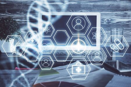 Desktop computer background and DNA drawing. Double exposure. Science concept. Reklamní fotografie