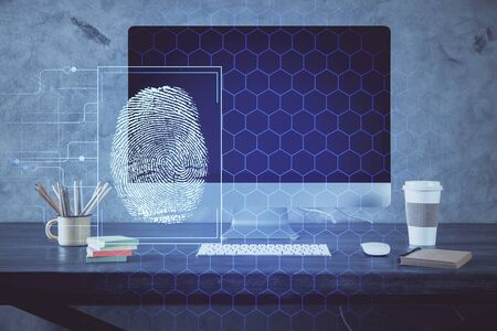 Computer on desktop in office with finger print drawing. Double exposure. Concept of business data security. Reklamní fotografie - 135499845