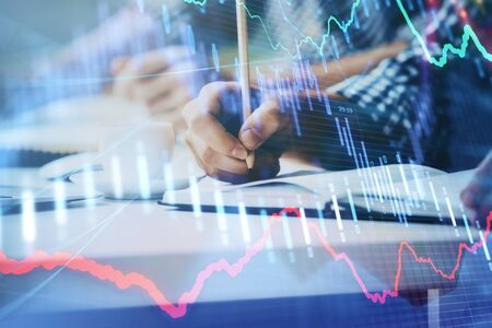 Multi exposure of two men planing investment with stock market forex chart background. Concept of research and trading. Reklamní fotografie - 135499860