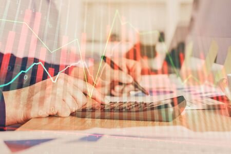Financial trading graph multi exposure with man desktop background. Concept of success. Reklamní fotografie