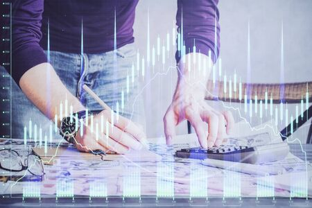 Multi exposure of man standing and planing investment with stock market forex chart. Reklamní fotografie - 135499898