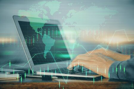 Double exposure of businessman with laptop and stock market forex chart. Reklamní fotografie - 135500683