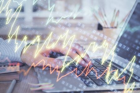 Double exposure of businessman with laptop and stock market forex chart.