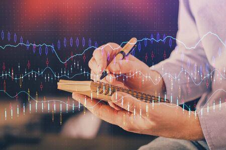 Double exposure hands with stock market chart. Reklamní fotografie - 135502350