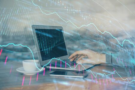 Double exposure of businessman with laptop and stock market forex chart. Reklamní fotografie - 135502342